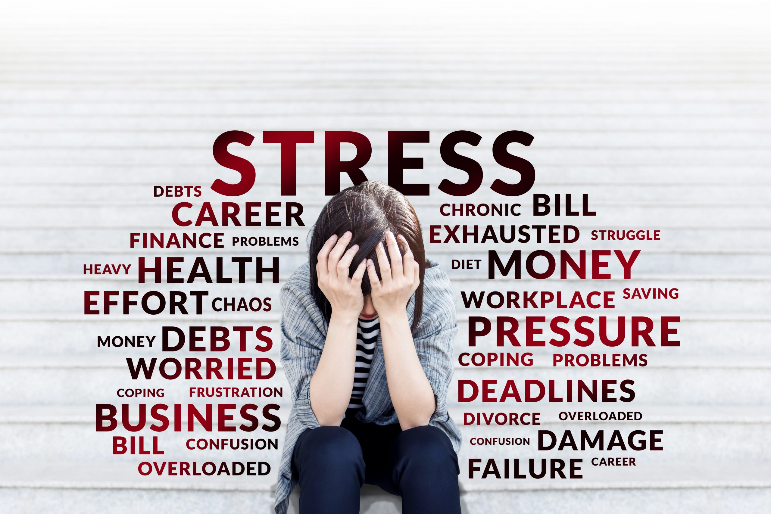 Business woman in Stress moment sitting on stair outdoor, hands on head with bad headache, Surrounded with Negative and depress wording